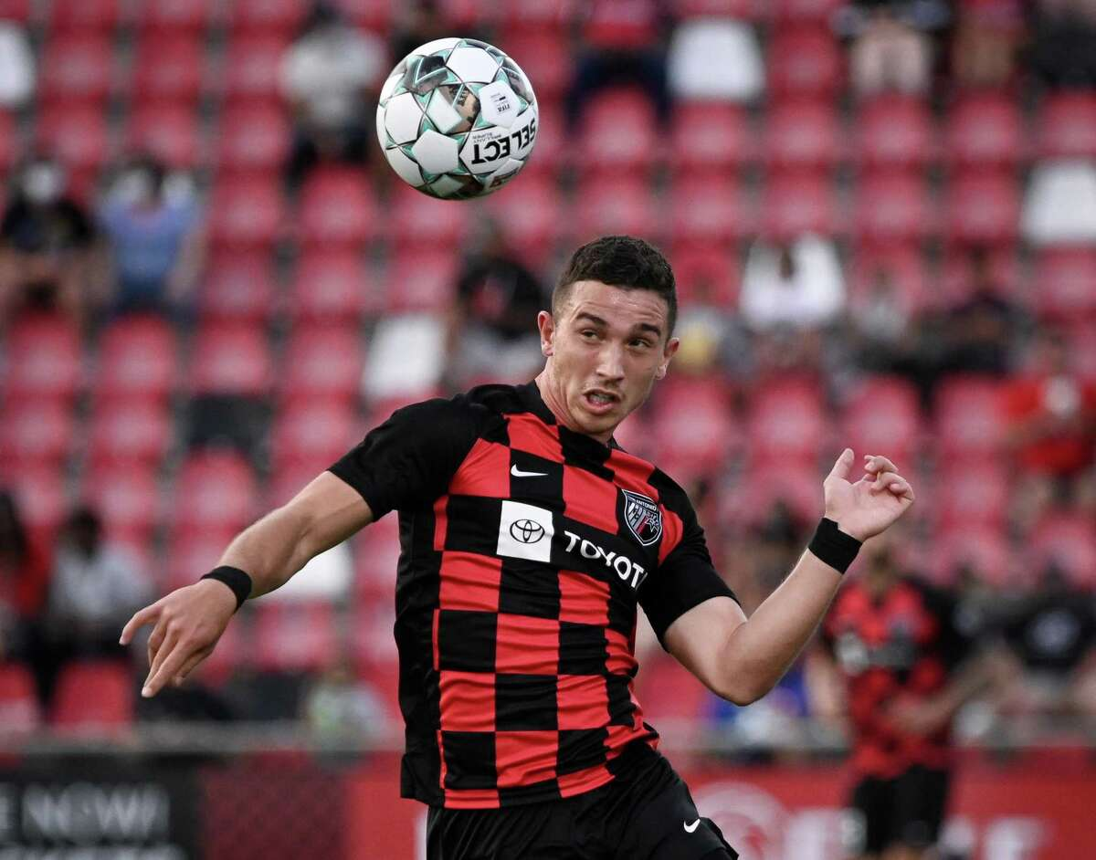 San Antonio FC's Nathan Fogaca plays a high ball during a match against Real Monarchs FC on Saturday, May 8, 2021, at Toyota Field in San Antonio.