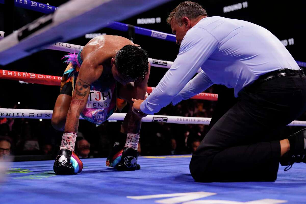The referee issues the count to Mario Barrios after Gervonta Davis hit Barrios during the WBA super lightweight world championship boxing match on Sunday, June 27, 2021, in Atlanta.