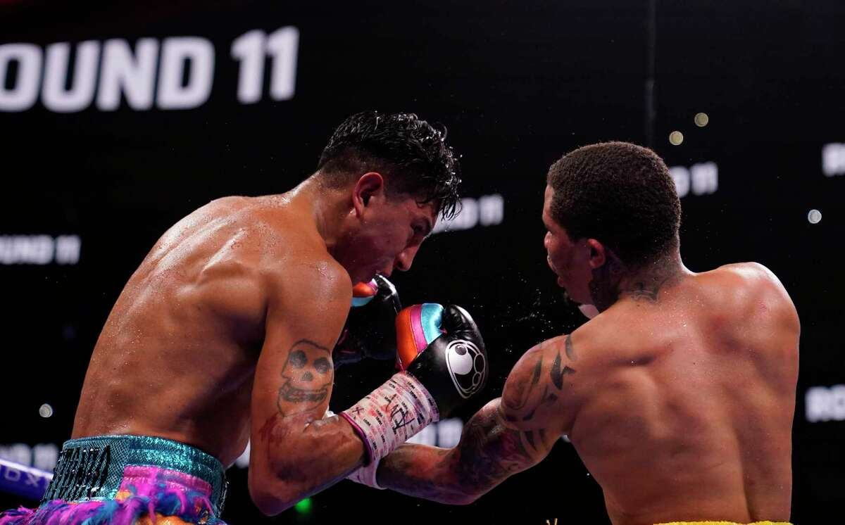 Gervonta Davis hits Mario Barrios with an uppercut during the WBA super lightweight world championship boxing match before on Sunday, June 27, 2021, in Atlanta. Davis won the fight on an 11th-round TKO.