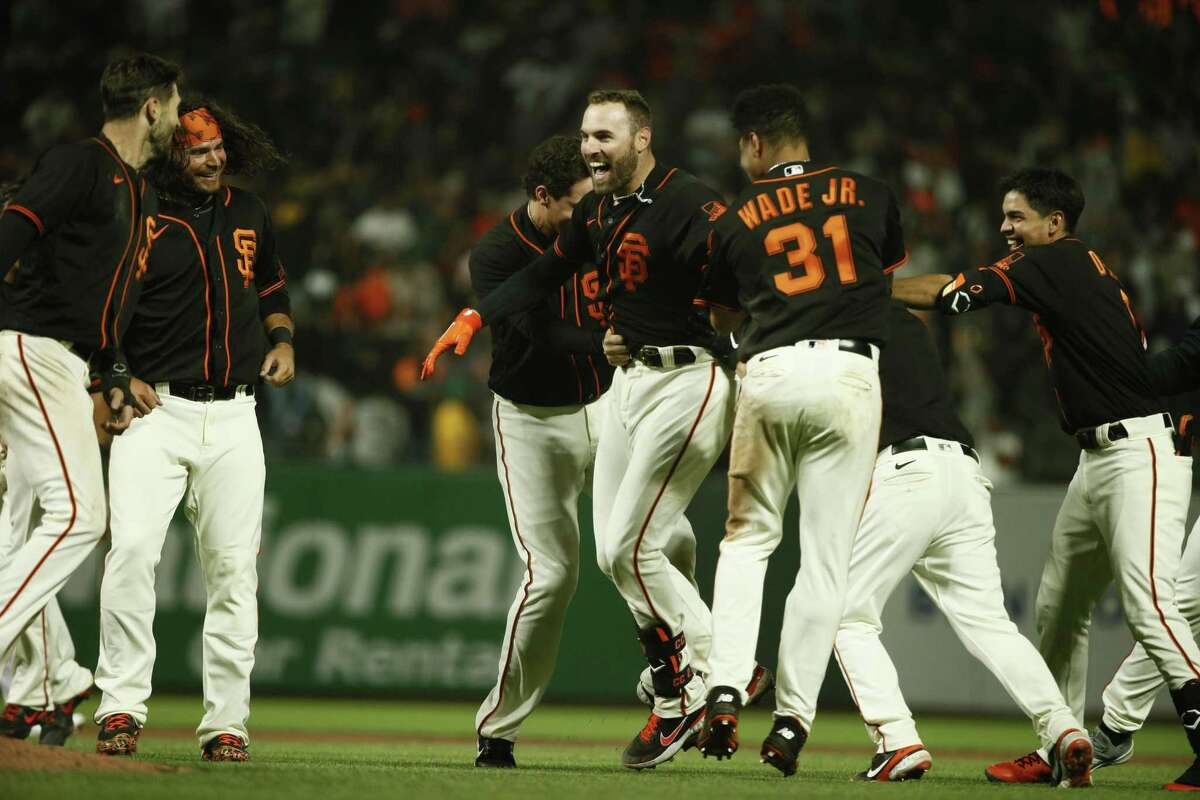 San Francisco Giants Curt Casali (2) celebrates the win with his double that brings in the winning run Steven Dugger in the tenth inning during an MLB game against the Oakland Athletics at Oracle Park, Saturday, June 26, 2021, in San Francisco, Calif. The Giants won 6-5.