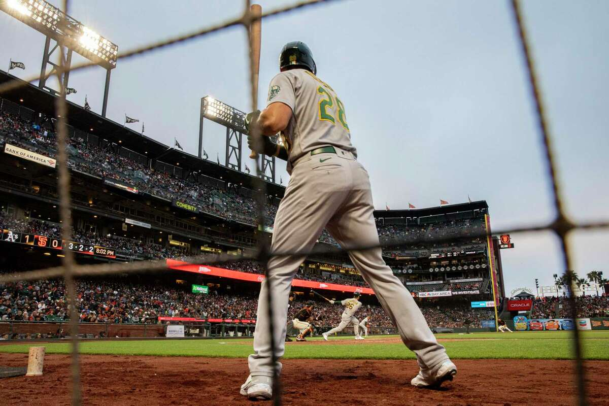 Oakland Athletics Matt Chapman (26) fouls a ball off as Athletics Matt Olson (28) is on deck in the second inning during an MLB game against the San Francisco Giants at Oracle Park, Saturday, June 26, 2021, in San Francisco, Calif.