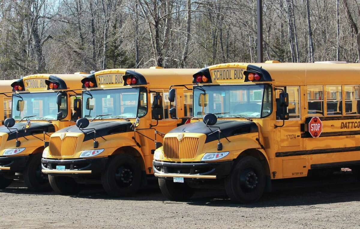 DATTCO school buses line up at the body shop on Tuttle Road in Middletown.