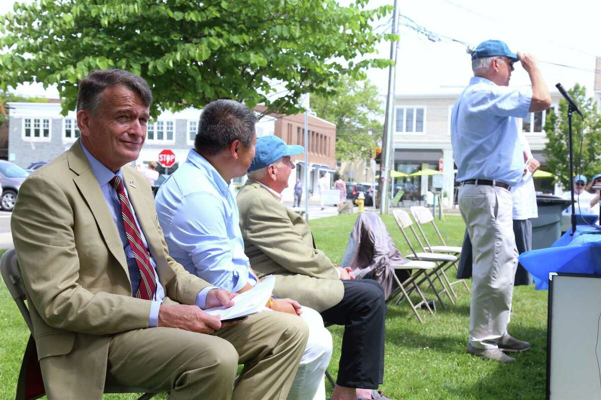 Christian Saunders, U.N. assistant secretary-general with the Department of Operations Support , at left, joins officials at the 56th jUNe Day Celebration ceremony on Jesup Green on Saturday, June 26, 2021 in Westport, Conn.