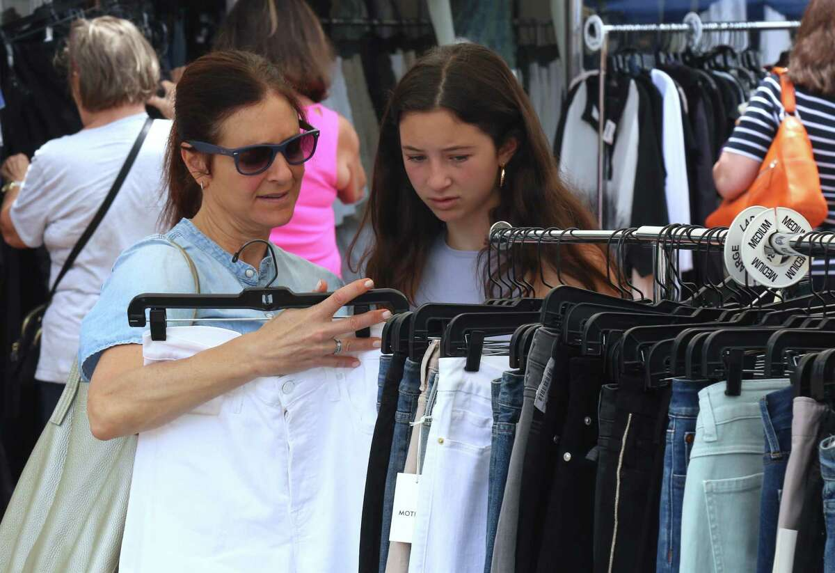 Lisa Weitzman of Westport and her daughter Maya Sherman check out some stuff at the Sidewalk Sale on Saturday, June 26, 2021.