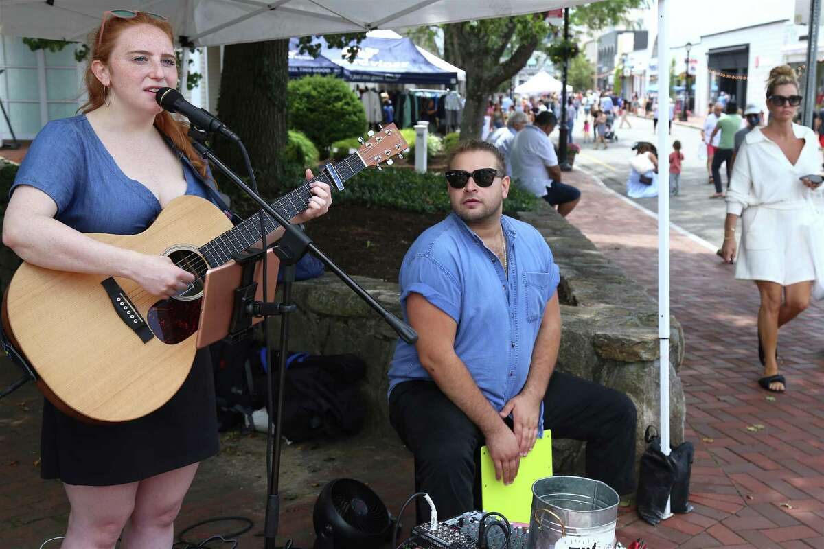 """Westport native Melissa Wasserman, now of New York City, performs with Reed Silverstein of Northville, N.J., as """"Wass"""" at the Sidewalk Sale on Saturday, June 26, 2021."""