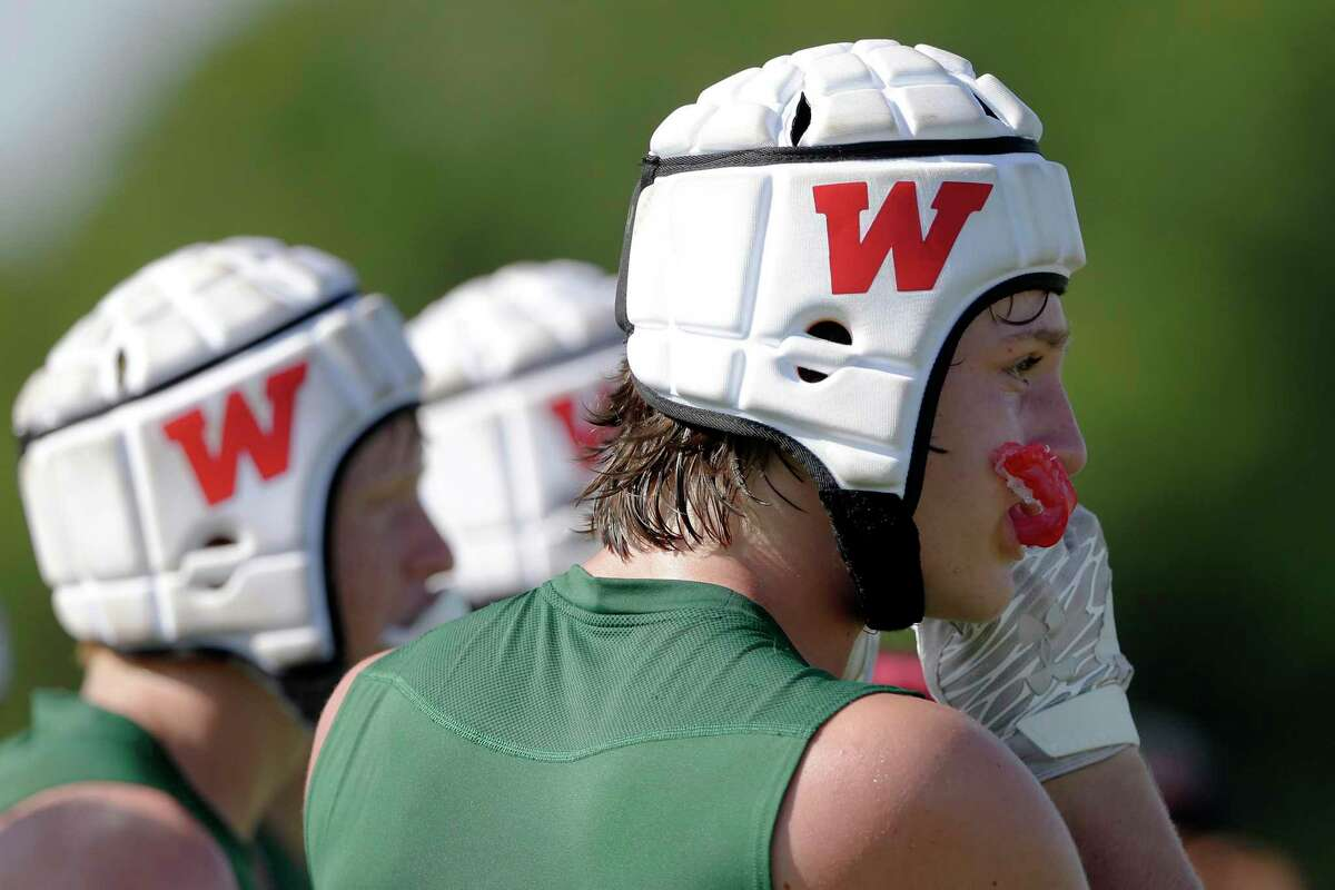 A Woodlands player chews his mouth guard during their second round game against Tompkins in the 7-on-7 state tournament held at Veterans Park Saturday, Jun. 26, 2021 in College Station, TX.