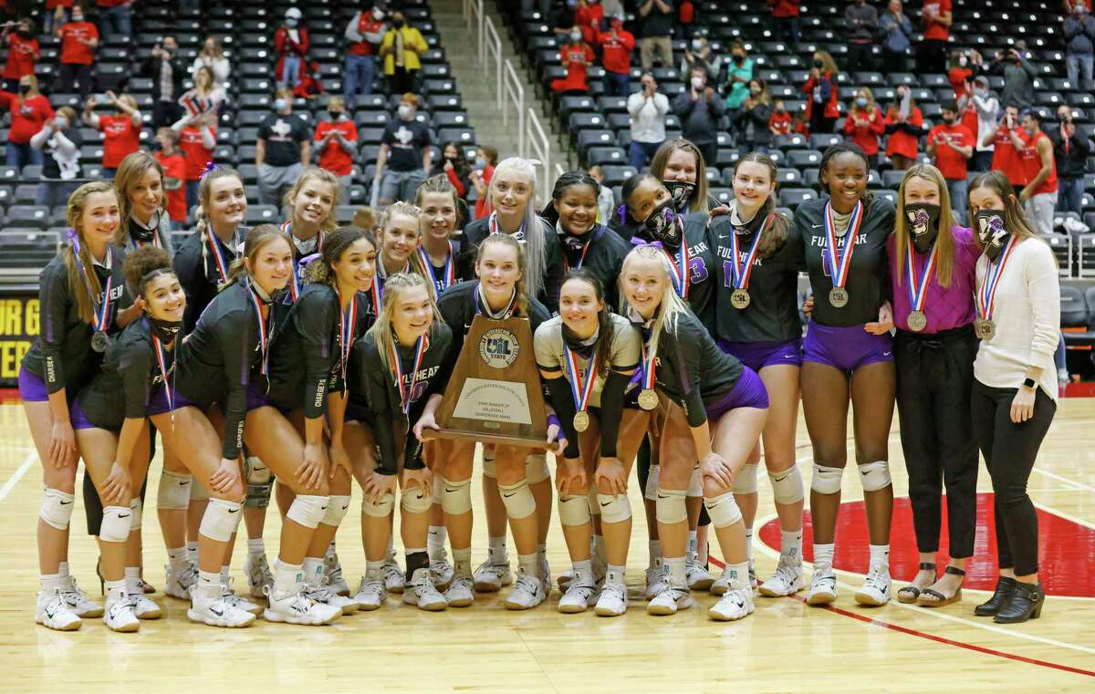 Fulshear players and coaches pose with the runner up trophy after losing to Lucas Lovejoy during the Conferece 5A State High School volleyball championship in Garland, Texas on Dec. 12, 2020. (Michael Ainsworth/ Contributor)