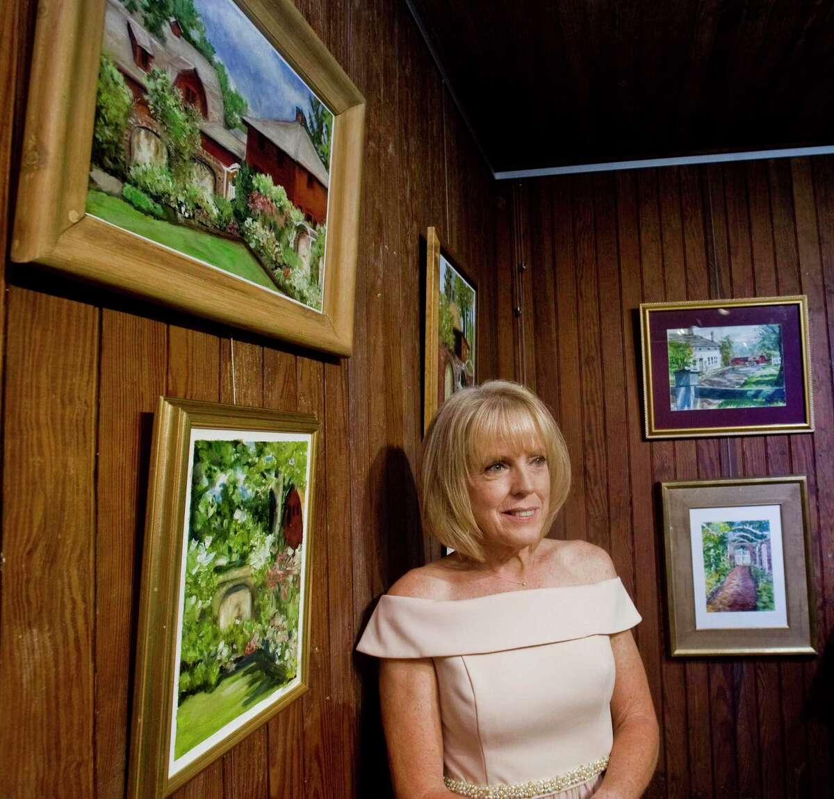 Judi Lynch, mother-of-the-bride, assembled a gallery of original artwork for guests to enjoy in the Cass Gilbert Carriage Barn on the day of her daughter's wedding at Keeler Tavern Museuem in Ridgefield. Friday, June 25, 2021.