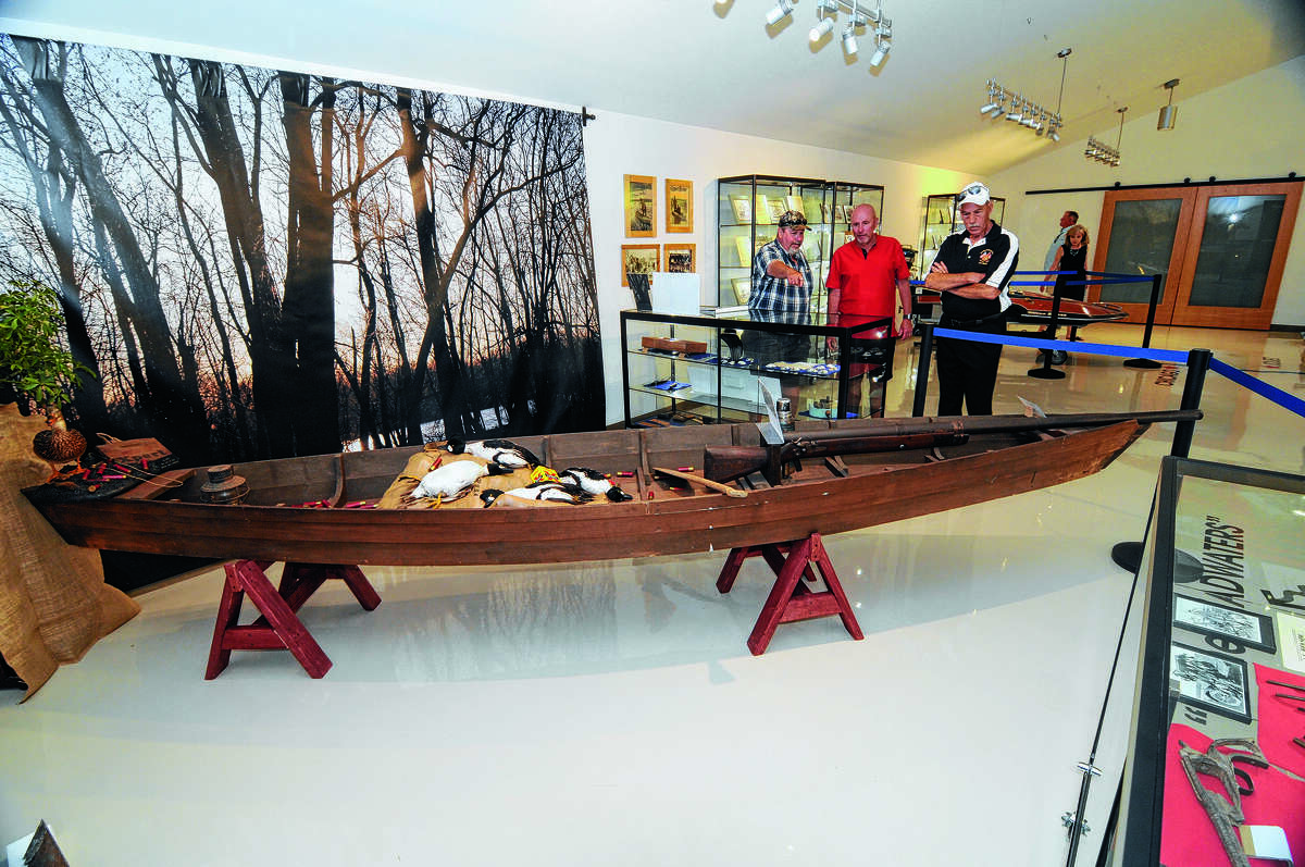 Visitors view a duck hunting exhibit at the Edward Amburg History Museum.