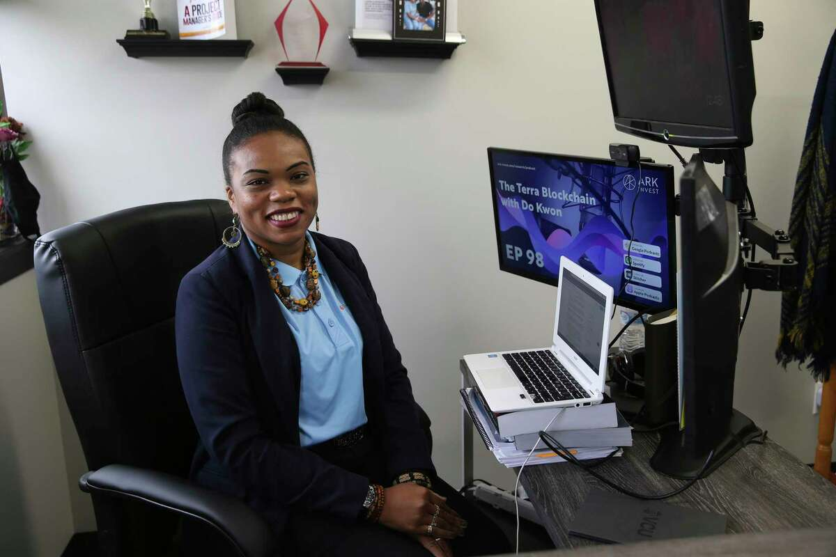 La Juana Chambers Lawson, owner and principal of Tacit Growth Strategies, works in her office Friday, June 25, 2021.