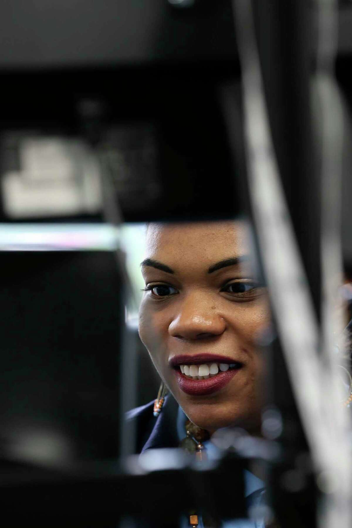 La Juana Chambers Lawson, owner and principal of Tacit Growth Strategies, works in her office Friday.