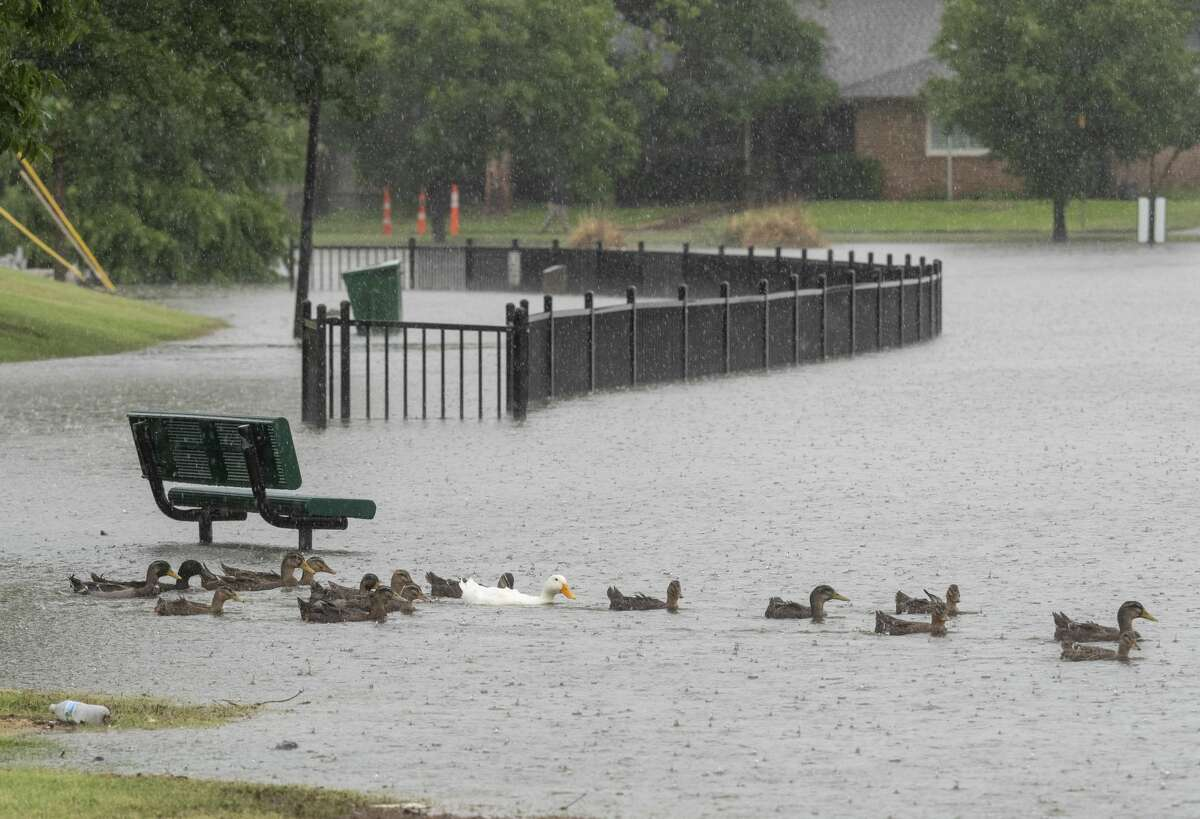 Heavy rains overnight and early 06/27/2021 have caused Wadley Barron Park to flood its banks, covering the walkway around the park. Tim Fischer/Reporter-Telegram