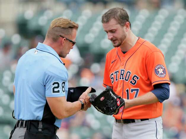 Houston Astros pitcher Jakje Odorizzi (17) is inspected by home plate umpire Jim Wolf (28) after pitching in the first inning of a baseball game against the Detroit Tigers Sunday, June 27, 2021, in Detroit. (AP Photo/Duane Burleson) Photo: Duane Burleson, Associated Press / Copyright 2021 The Associated Press. All rights reserved.