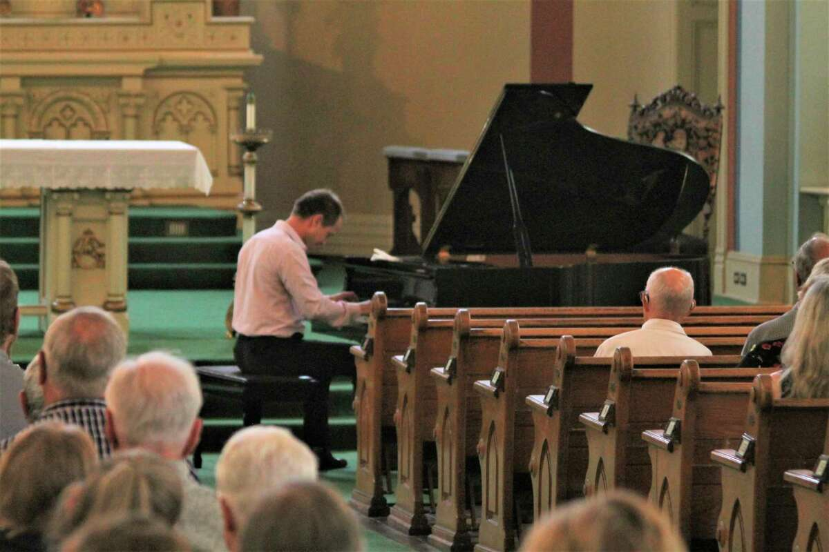 Classical pianistNakita Sokolov performs during a free concert at Guardian Angels Church in Manistee on Saturday. The event was hosted by theGuardian Angels Historic Preservation Project and all donations will gotoward the current phase of building restoration work atthe church. (Kyle Kotecki/News Advocate)