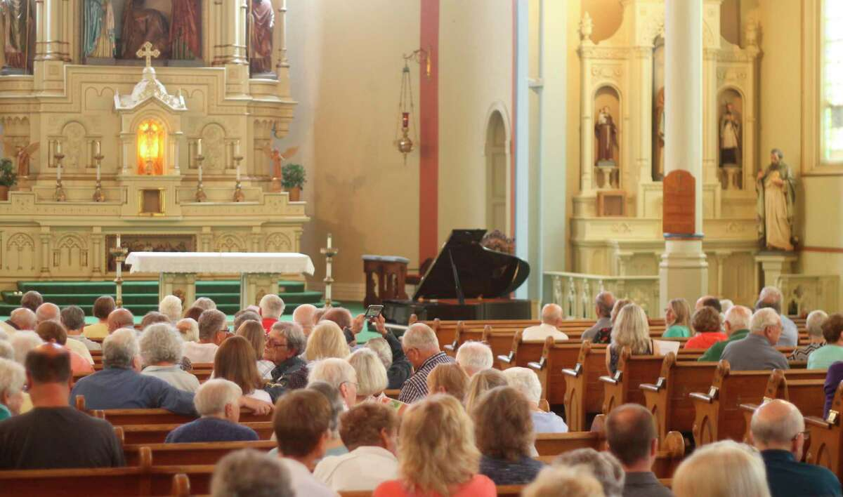 Over 200 people attended a free concert at the Guardian Angels Church in Manistee on Saturday. The event was hosted by theGuardian Angels Historic Preservation Project and over $3,500 was raised through donations which will go toward building restoration work at the church. (Kyle Kotecki/News Advocate)