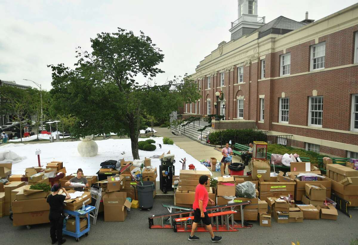 Set decorators transform the New Canaan Town Hall property into a Christmas scene for the filming of the Netflix movie The Noel Diary in New Canaan, Conn. on Sunday, June 27, 2021.