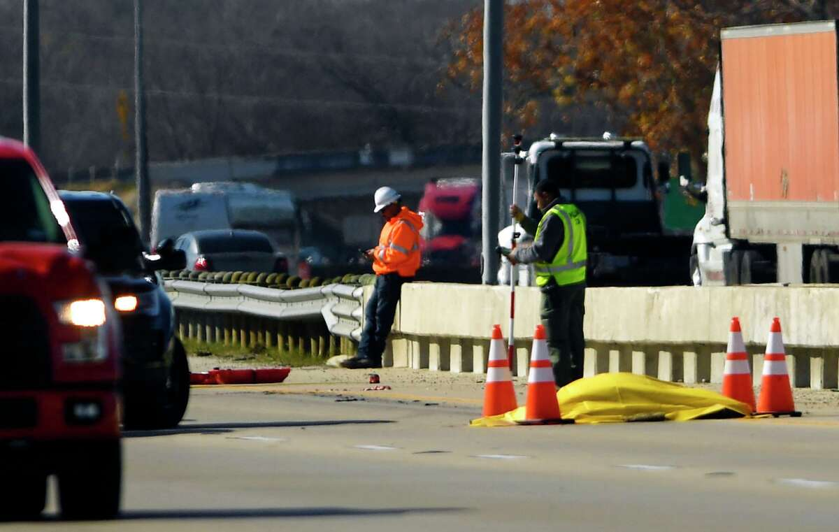 The body of a 19-year-old man rests on Interstate 35 North near Loop 1604 after he was run over by an 18-wheeler on the Southwest Side on Jan. 3, 2020.