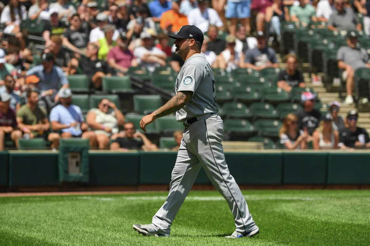 Seattle pitcher Hector Santiago leaves the field after being ejected from the game after umpires found a substance on his glove in the fifth inning against the White Sox on Sunday.