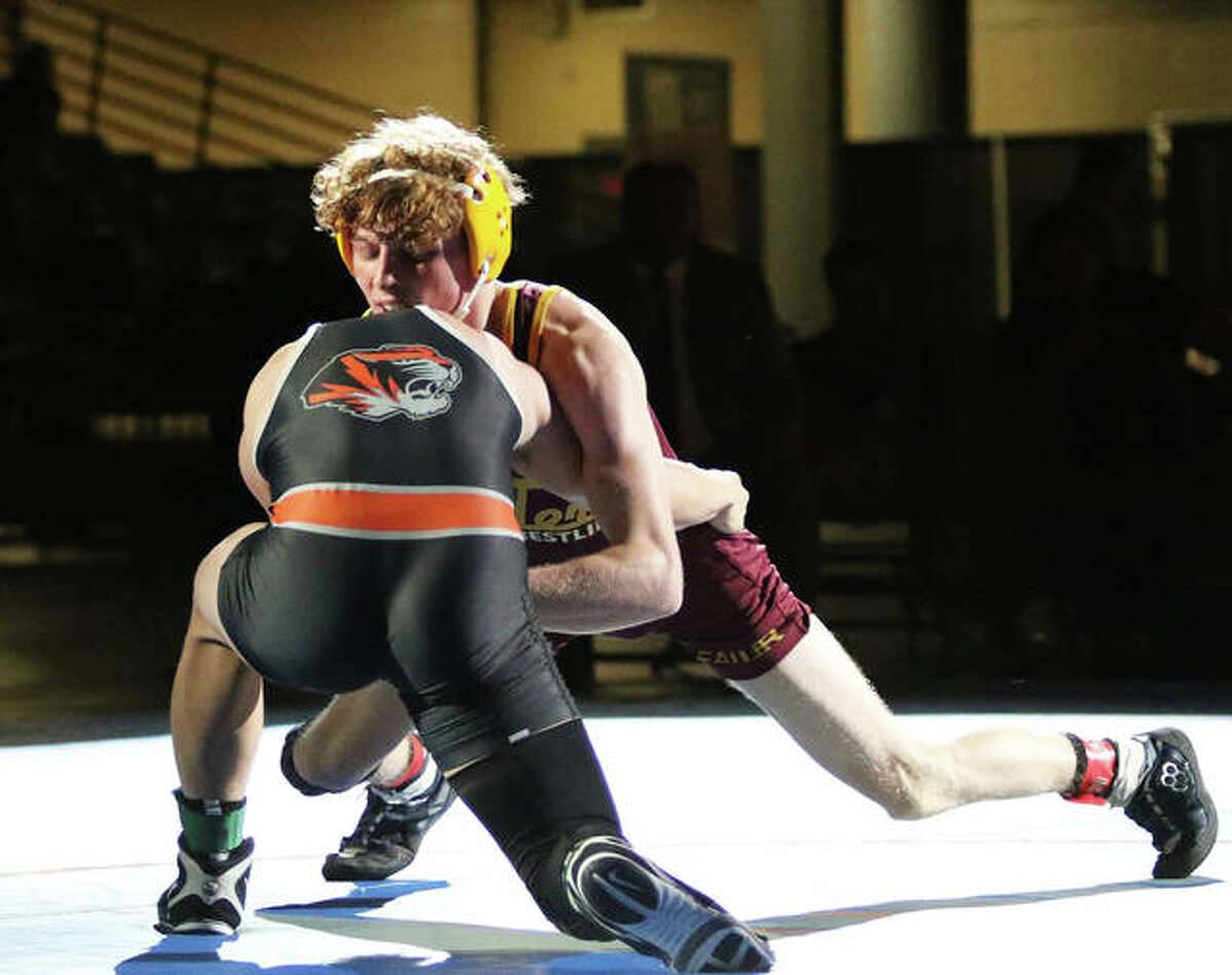 EA-WR junior Jason Shaw (right) tries to gain an advantage against Illini Bluffs' Paul Ishikawa in the 126-pound championship match at the IWCOA Class 1A state wrestling meet Thursday in Bank of Springfield Center in Springfield. Shaw lost a 3-1 decision in overtime to finish his season at 27-2.