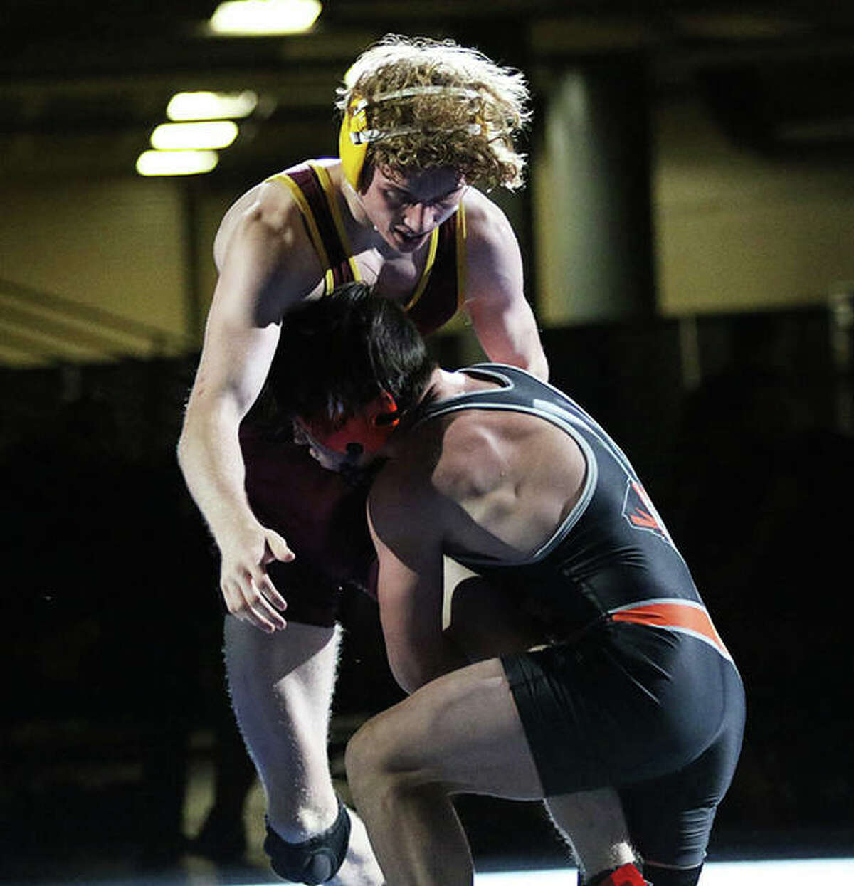 Illini Bluffs' Paul Ishikawa wraps up the left leg of EA-WR's Jason Shaw (back) and takes him off the mat for a takedown in the final seconds of overtime to win their 126-pound title match Thursday in the Class 1A state meet in Springfield.