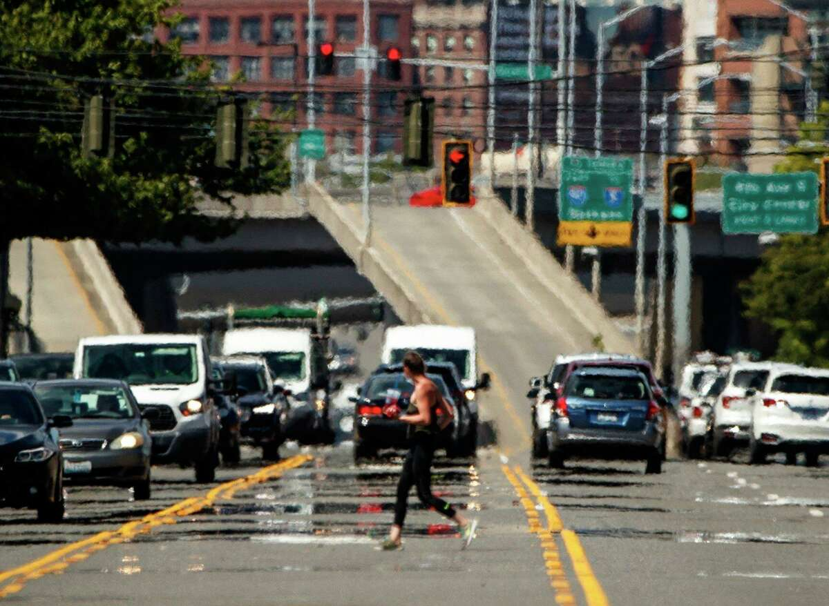 Heat waves distort a street scene in the Sodo neighborhood of Seattle on Wednesday., June 23, 2021. (Amanda Snyder/The Seattle Times via AP)