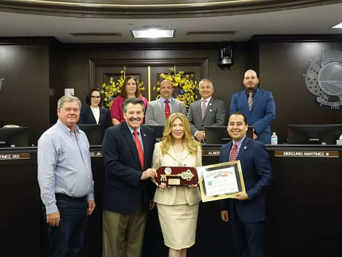 Pictured from left in the front are Webb County Commissioner for Precinct 3 John Galo, Mayor Pete Saenz, Ana Benavides Galo and District IV Councilmember Alberto Torres, Jr. In the back row are District VIII Councilmember Alyssa Cigarroa, District VI Councilmember Vanessa Perez, District V Councilmember Ruben Gutierrez, Jr., District III Councilmember Mercurio Martinez, III and District II Councilmember Vidal Rodriguez.
