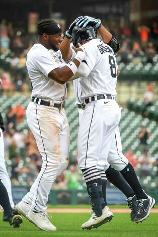 DETROIT, MICHIGAN - JUNE 27: Akil Baddoo #60 of the Detroit Tigers, left, and Robbie Grossman #8 of the Detroit Tigers celebrate their win against the Houston Astros after Baddoo scored a run on a sacrifice bunt by Grossman during the bottom of the tenth inning at Comerica Park on June 27, 2021 in Detroit, Michigan. Photo: Nic Antaya, Getty Images / 2021 Getty Images