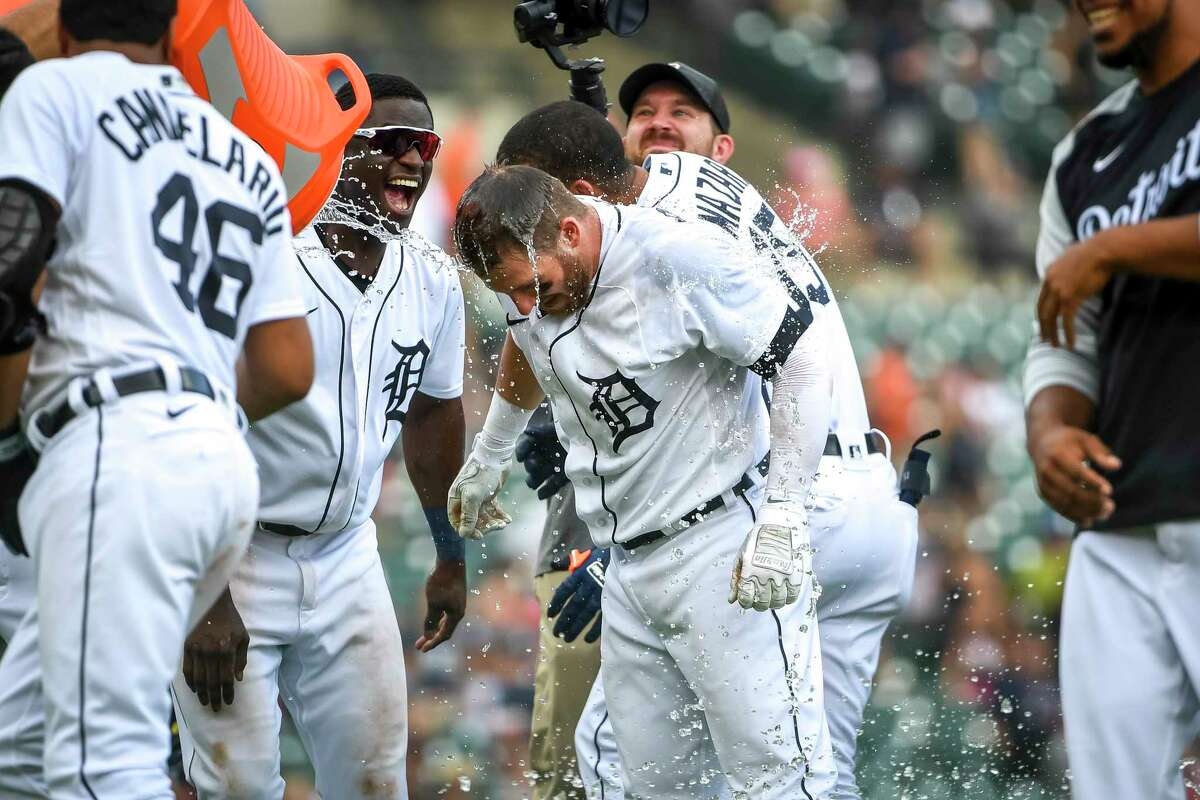 DETROIT, MICHIGAN - JUNE 27: The Detroit Tigers celebrate their win against the Houston Astros by pouring water on Robbie Grossman #8 of the Detroit Tigers during the bottom of the tenth inning at Comerica Park on June 27, 2021 in Detroit, Michigan.