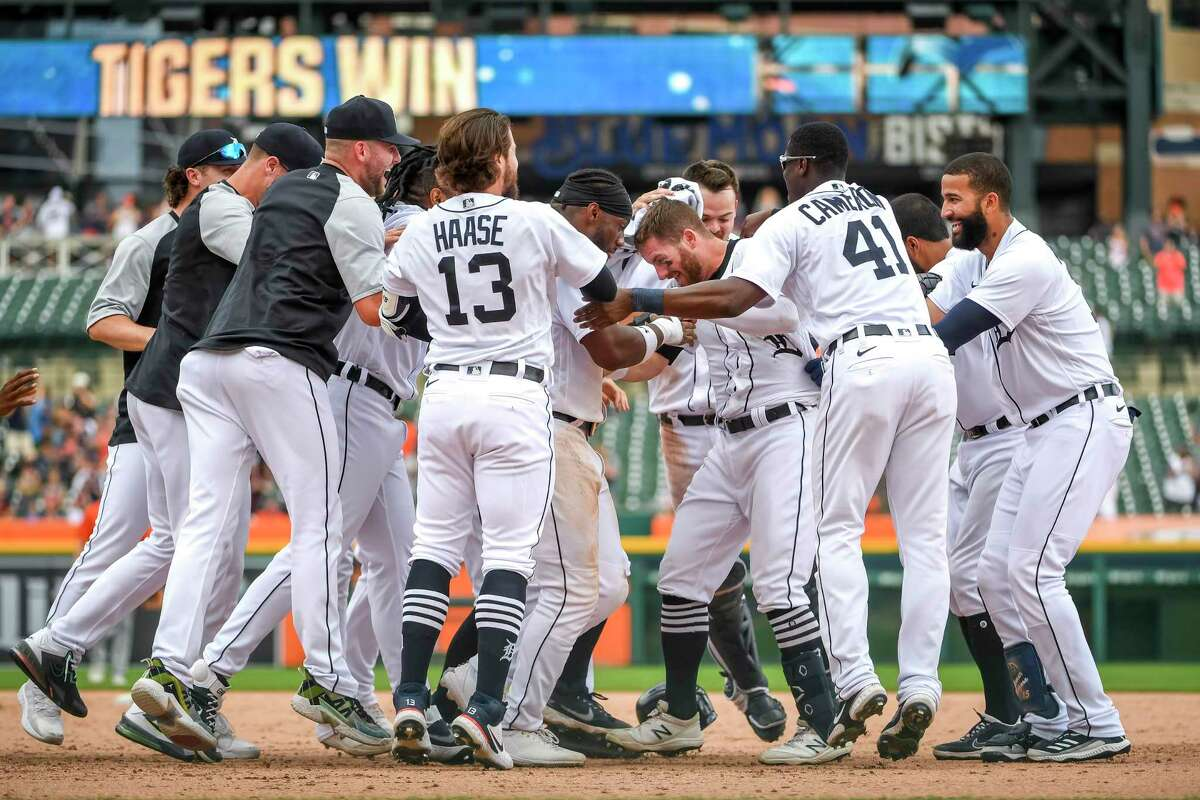 DETROIT, MICHIGAN - JUNE 27: The Detroit Tigers huddle around Robbie Grossman #8 of the Detroit Tigers after defeating the Houston Astros in the bottom of the tenth inning at Comerica Park on June 27, 2021 in Detroit, Michigan.