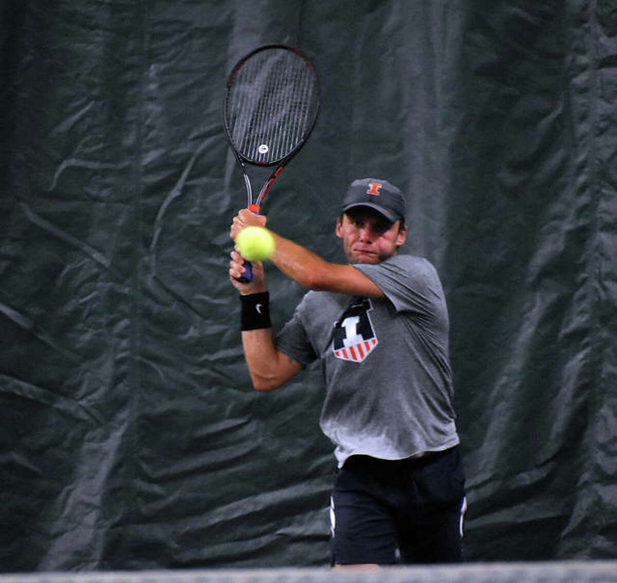 Zeke Clark smashes a backhand return during his singles championship match of the Edwardsville Open on Sunday.