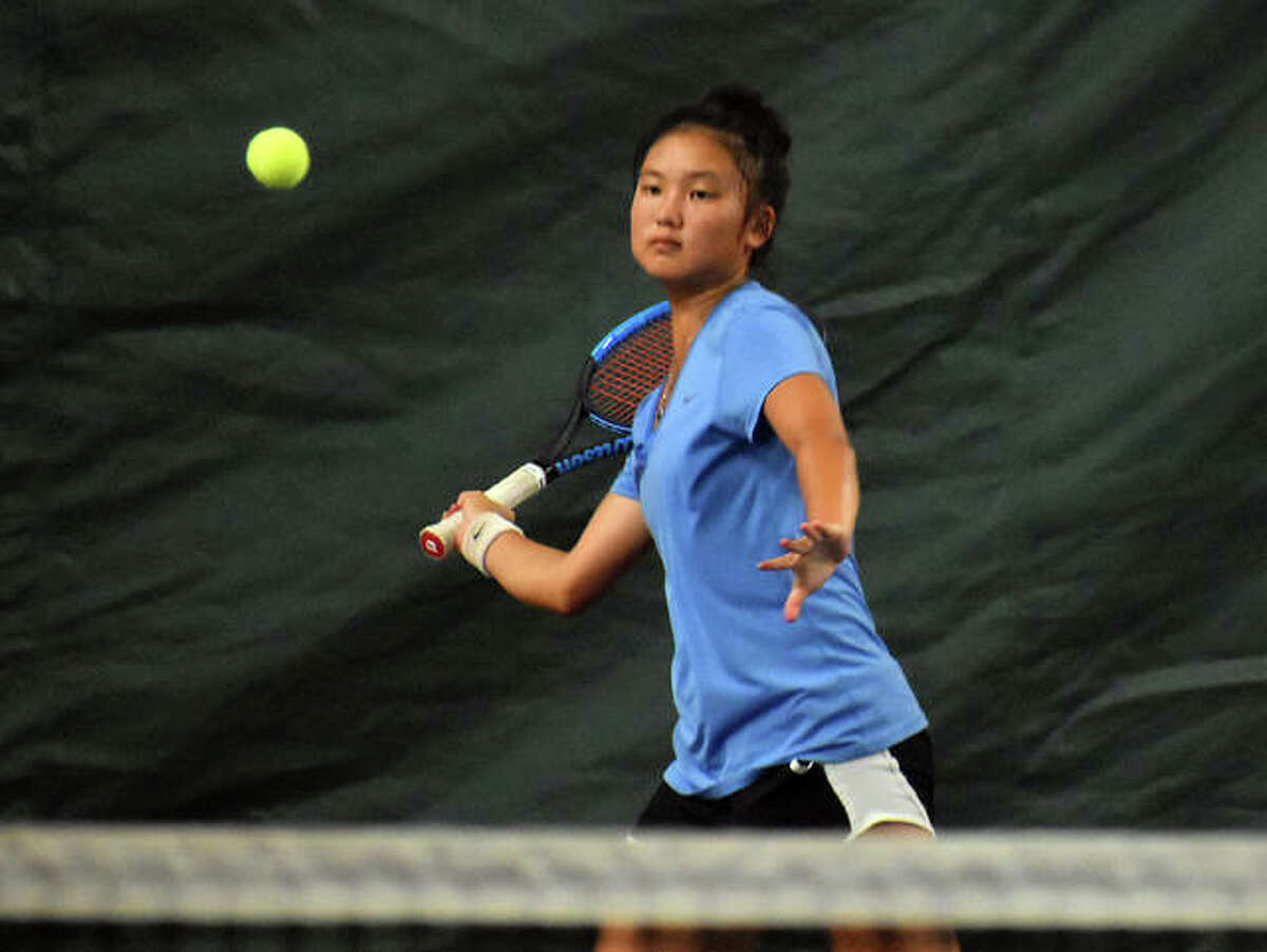 Edwardsville High School's Chloe Koons hits a forehand shot during her match in the final of the Edwardsville Open.