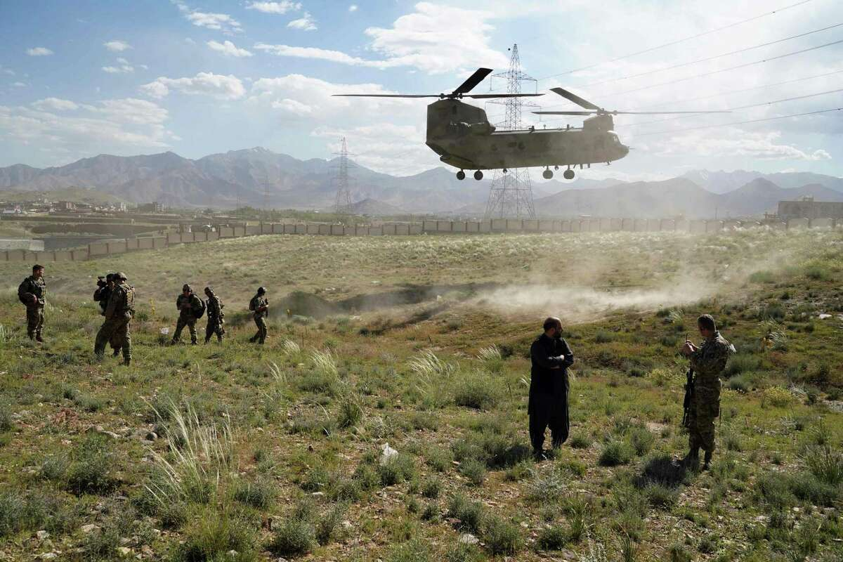 In this file photo taken on June 6, 2019, a U.S. military Chinook helicopter lands in Maidan Shar, Afghanistan. Photo by Thomas Watkins/AFP via Getty Images.