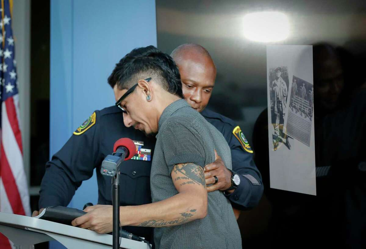 Houston Police Chief Troy Finner embraces Richard Molina, nephew of Jose 'Joe' Campos Torres, the man killed by police in 1977, pauses before gave a formal apology to the family for the murder Sunday, June 27, 2021, in Houston.