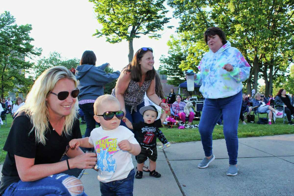 Parents and children dance to the music of The Pop Rocks during West Haven's centennial celebration.
