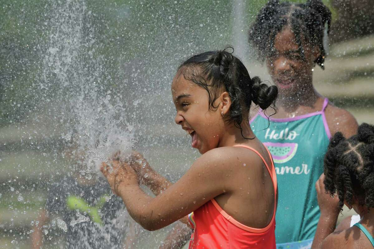 Lilly Fraser, left, 8, and her sister, Riley Fraser, 11, cool off at the spray park in Riverfront Park along the Hudson River on Sunday, June 27, 2021, in Troy. The National Weather Service says it will be imperative to find ways to stay cool through Wednesday.(Paul Buckowski/Times Union)