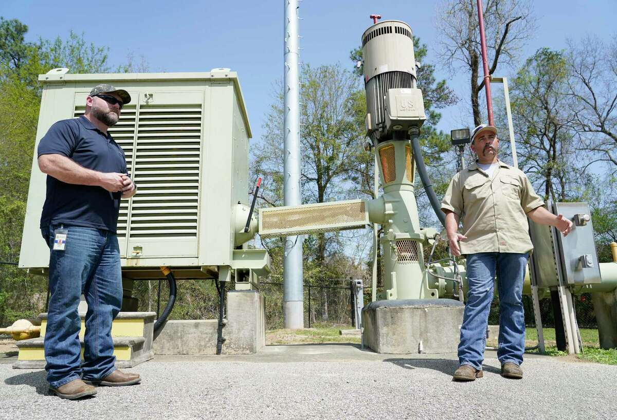 Jason Williams, operation manager, left, and Jacob Everett, chief maintenance technician, right, talk at the San Jacinto River Authority Water Well No. 2 Wednesday, March 17, 2021 in The Woodlands.