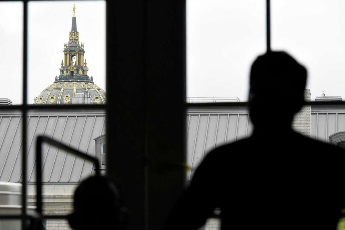 City Hall's minaret is seen from a window of 50 United Nations Plaza in San Francisco on May 6, 2016.