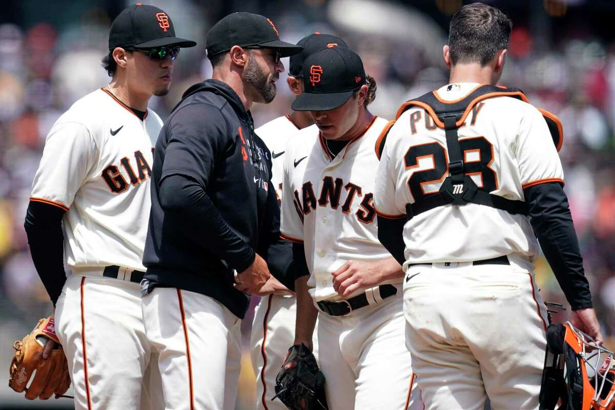 San Francisco Giants pitcher Sammy Long, second from right, walks off the mound after being taken out for a relief pitcher by manager Gabe Kapler, second from left, during the sixth inning of a baseball game against the Oakland Athletics in San Francisco, Sunday, June 27, 2021. (AP Photo/Jeff Chiu)