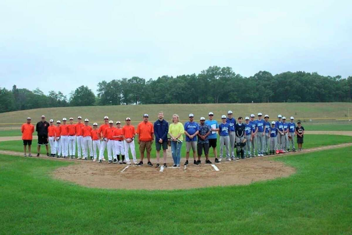 Manistee celebrates the memory of umpire Jeff Stewart who died of a heart attack while umpiring a tournament game last year. (Courtesy photo)