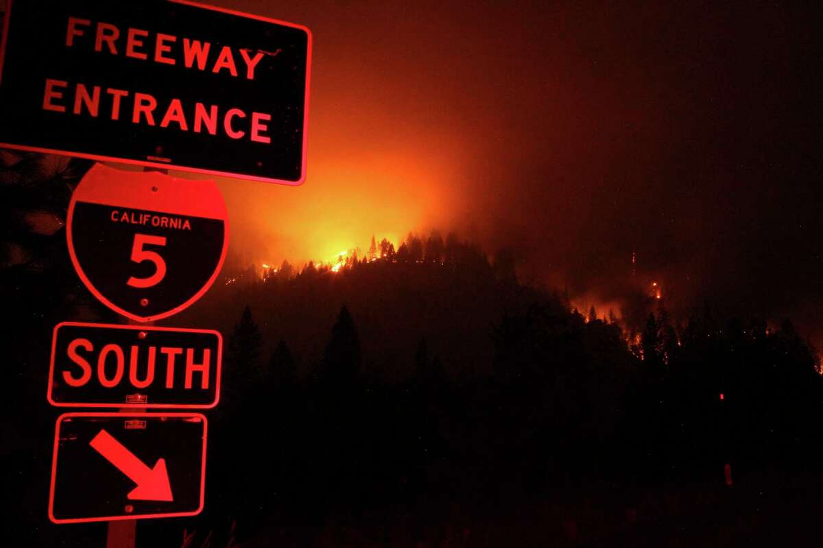 Wildfire burns in 2018 east of I-5 just south of Gibson Road exit near Shasta-Trinity National Forest. Firefighters are battling a blaze in the region and have warned residents of Weed to be ready to evacuate as needed.