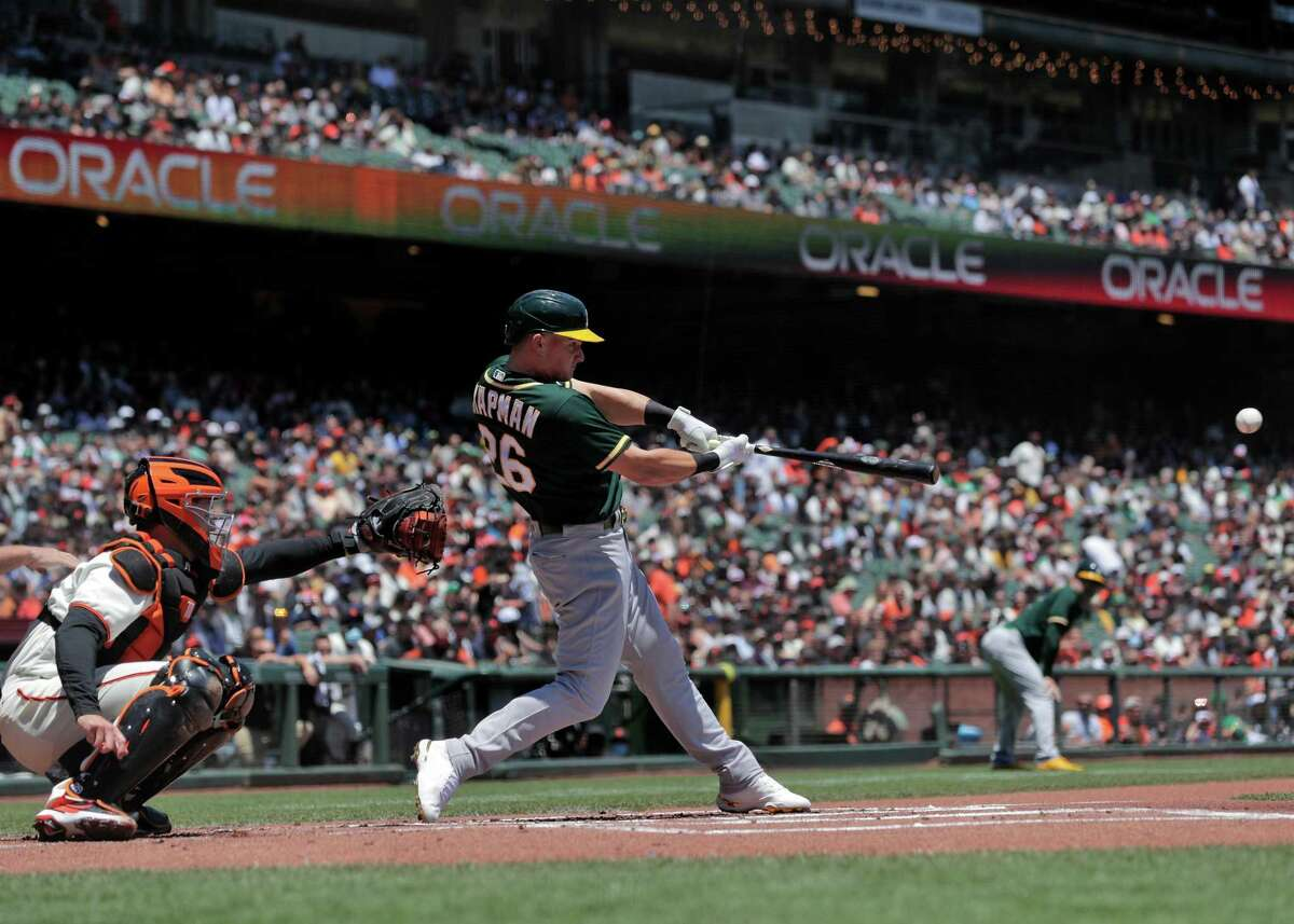 Matt Chapman (26) hits a two-rbi single that scored Elvis Andrus (17) and Matt Olson (28) in the first inning as the San Francisco Giants played the Oakland Athletics at Oracle Park in San Francisco, Calif., on Sunday, June 27, 2021.