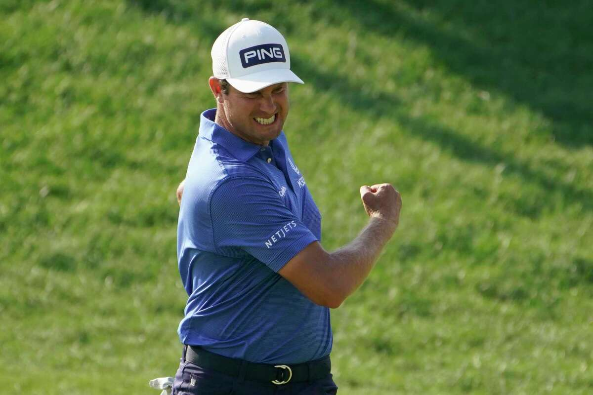Harris English celebrates a birdie on the 18th green during the final round of the Travelers Championship on Sunday.