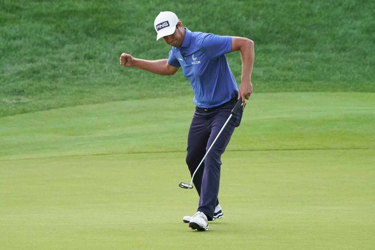 Harris English reacts to winning the Travelers Championship on the eighth playoff hole at TPC River Highlands on Sunday.