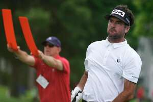 Bubba Watson watches his shot on the third tee during the final round of the Travelers Championship on Sunday.