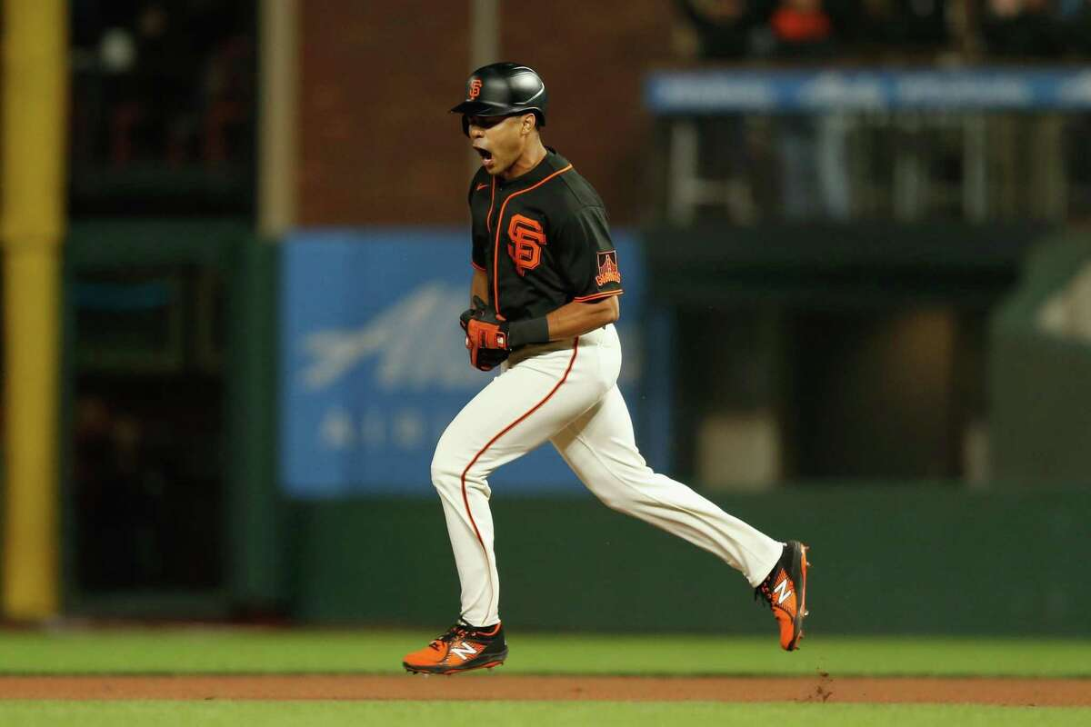 The Giants' LaMonte Wade Jr. #31 of the San Francisco Giants celebrates as he rounds the bases after hitting a two-run home run in the bottom of the fifth inning against the Oakland Athletics at Oracle Park on June 26, 2021 in San Francisco, California. (Photo by Lachlan Cunningham/Getty Images)