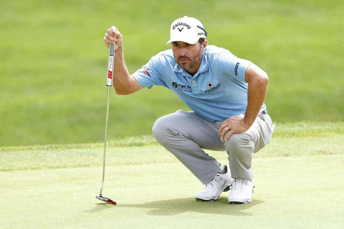 Kevin Kisner looks over a putt on the 18th green during the final round of the Travelers Championship on Sunday.