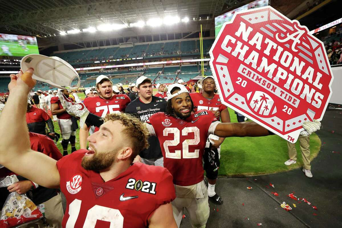 Alabama Crimson Tide players celebrate their national championship in January. College athletics is big business. It's past time for such athletes to be paid for their efforts.
