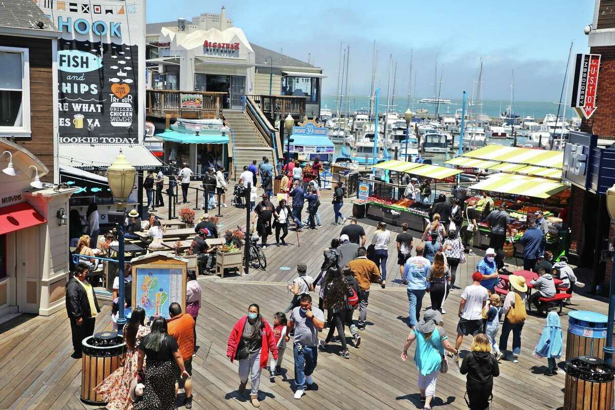 A diverse crowd walks through Pier 39 in San Francisco. The state's population growth has slowed in the past decade, and its population growth was due almost entirely to Asian and Latino residents.