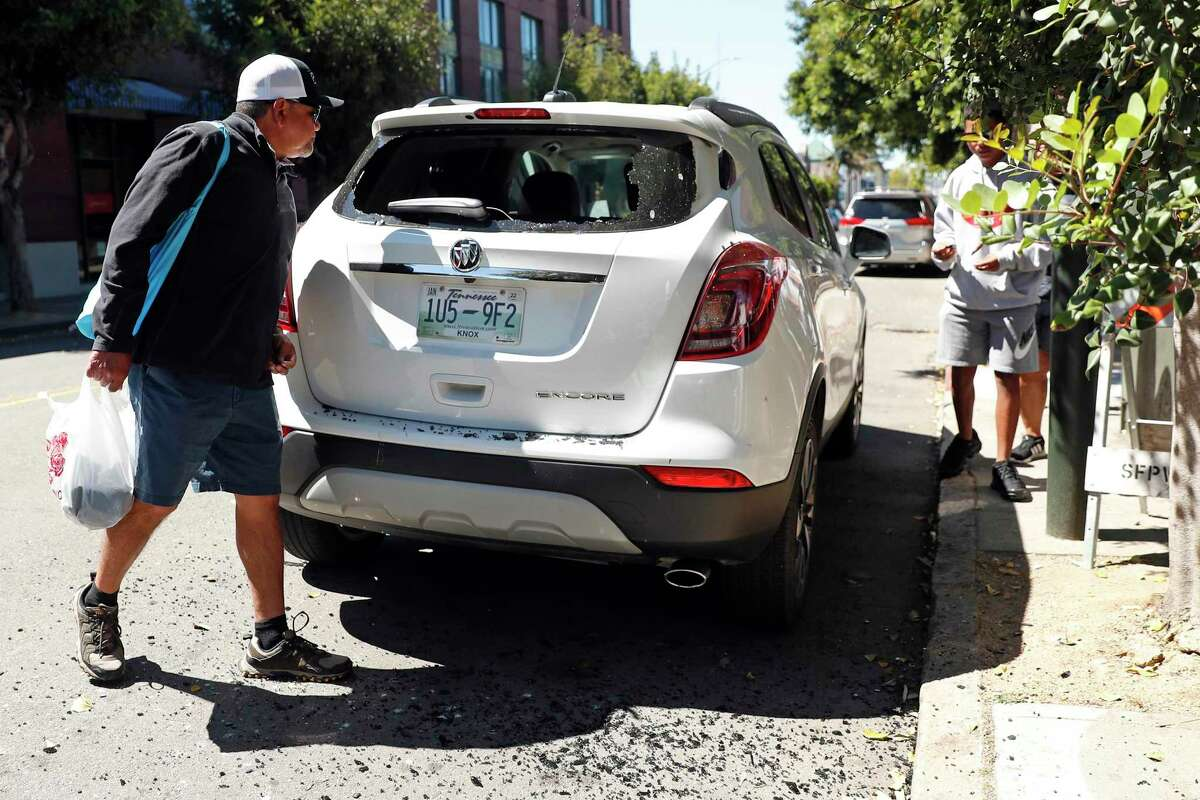 Texas tourist, Juan Montanez, arrives back at his rental car after it was broken into on Taylor Street near Fisherman's Wharf in San Francisco, Calif., on Thursday, June 24, 2021. Montanez had an iPad and luggage stolen from the back of their SUV that had Tennessee license plates.