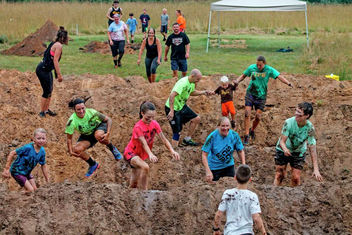 The Muddy Fox Trot provides plenty of good, family fun for people of all ages as indicated by the photograph. The annual fundraiser benefits the West Shore Community College student scholarship fund. (Courtesy photo)